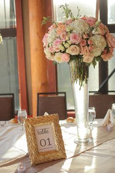 Tall pink centerpiece | Rustic Elegant Pink and Gold Wedding via TheELD.com