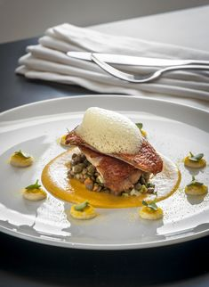 Pan fried red mullet on ginger scented lentils, carrot fennel cream and passion fruit taramosalata at Grace Santorini.