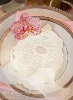 Custom menus accented with orchids. Menus by PALETTERA Custom Correspondences.