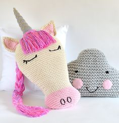 Knitting Pattern for Unicorn and Cloud Pillows - 2 patterns in 1. Finished Dimensions: Unicorn (without horn) 17″ x 9.75″ (43cms x 25cms); Cloud: 15″wide x 9.5″ high (38cms x 24cms). You could also leave the horn off the unicorn to make a horse pillow. tba fantastical creatures