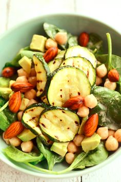 Healthy salad: spinach, chick peas, avocado, courgette and almonds...so yammy. I would use a pinch of himalayan salt and nice bowl of yogurt