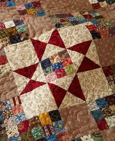 Marae Harris machine-quilted an allover spiral-and-flower motif in the background of the quilt.