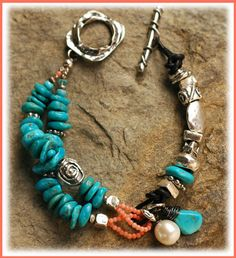 ~Untamed Spirit Too...  Nuggets of Sleeping Beauty Turquoise and handcrafted artisan silver. Coral, Apatite and Leather.  Bracelet size.......7.0 inches fits a wrist size 6.25 to 6.75