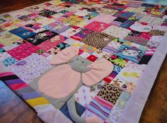 baby clothes quilt. Love this. Would be a great idea for a first birthday gift.