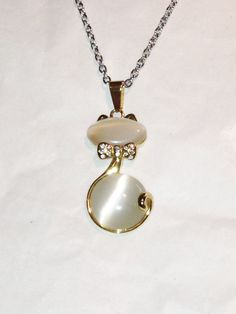 Vintage White Cat Necklace Cats Eye Kitten by NorthCoastCottage Jewelry Design & Vintage Treasures, on Etsy.com, $49.00.