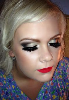 Gold to black vintage smokey eyes with big lashes and red lips. <3