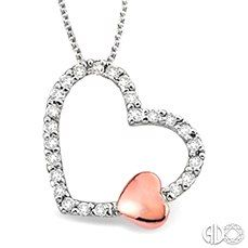 See the Romantic Beauty of this Diamond Heart Pendant with a Precious 10k Pink Gold Accent.