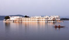 Exceptionally romantic, the Taj Lake Palace hotel in Udaipur, India, is contained within a building on Lake Pichola. If it looks familiar that may be because it featured in the Bond film Octopussy. Top 10 Holiday Destinations, Honeymoon Destinations, James Bond, Udaipur India, India Palace, Jaipur, Unusual Hotels, Beste Hotels, India Tour