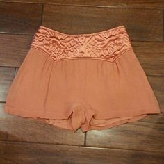 Topshop quilted waist shorts Side zip quilted waist lined sorts 100% viscous color is coral Topshop Shorts