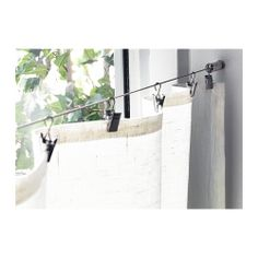 DEKA Curtain wire incl. clips IKEA Complete set with wall hardware, curtain wire and clips; ready to mount. Can be easily cut to the desired... 9' max for $9.99!! CHEAP