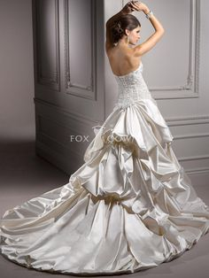beaded bodice wedding dress with soft shimmer satin skirt