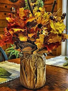 One of the easiest DIYs to try, this gorgeous vase is made with an empty Mason jar and a paper bag.  Get the tutorial at My Country Blog of This and That. RELATED: 14 Mason Jar Crafts That Will Get You Excited for Fall   - CountryLiving.com