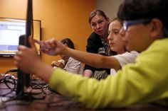 Twitter opens $3 million tech skills center for SF poor, homeless. By Joe Garofoli   Instructor Sarah Rich helps Alex Sanchez (center), 10, and Diego Castro, 9, during a coding class. Photo: Scott Strazzante / The Chronicle / ONLINE_YES