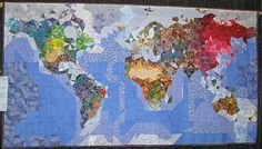 """""""Pieces of the Puzzle from the People of Our Planet"""" by Diane Lovitt.  PIQF 2011. Photo by CAQuilter"""