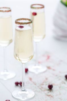 We can't think of a better way to wake up on Christmas morning: This merry drink is 2 parts champagne and 1 part white cranberry juice. Don't skip the red-green sanding sugar rim. First dip the glass in water to make sure the sugar sticks.