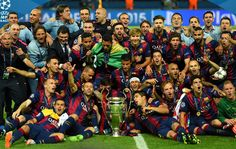 The Barcelona team celebrate victory with the trophy after the UEFA Champions League Final between Juventus and FC Barcelona at Olympiastadion on June 6, 2015 in Berlin, Germany.
