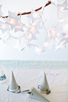 Paper star lights hung as a centerpiece for the #fourthofjuly and all summer long!