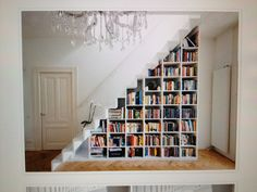 bookcase under stairs, but bigger sections that are see through, to put decorative pieces or dining ware