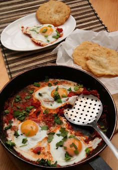 Egg Rougaille is a Mauritian-inspired dish, essentially a one pan dish of eggs softly poached in a spicy Creole tomato sauce.