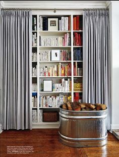 Curtained bookshelves could be a good idea in our farmhouse so that we aren't overwhelmed by the library.