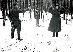 A Soviet spy laughs at his executioner in a picture taken in Rukajärvi, in East Karelia, Finland, in November 1942.The view within the Finnish Defence Forces was that photos like this, showing the fate of Russian POWs and spies, created the risk of pro-Soviet elements in Finnish society could have used the images for propaganda purposes. [http://www.hs.fi/english/article/Too+awful+an+image+of+war/1135223124092]