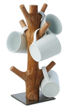 This organic mug tree is made from reclaimed section of mangosteen wood. When th., This organic mug tree is made from reclaimed section of mangosteen wood. When the mangosteen trees of vast Southeast Asian plantations cease to produc.