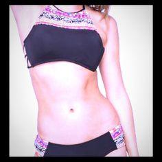Black halter bikini with colorful graphic details Black halter bikini with colorful aztec  graphic details, strappy back and cheeky bottom NWT Swimwear Tankini Swim Bikinis