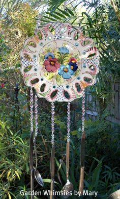 Decorative Plate with openings,hang beads & silverware, bells, etc. to make Windchime, Put on garden stake or hang. I love this!
