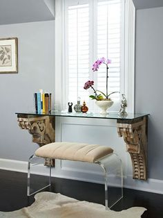 "make more of the space below a window by setting a shelf atop flush-mount brackets to create a ""floating"" desk."