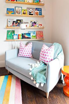 Gorgeous colorful playroom features a multi-colored striped rug placed in a fron… Gorgeous colorful playroom features a multi-colored striped rug placed in a front of a blue settee topped with pink plus pillows and an aqua herringbone throw. Playroom Design, Playroom Decor, Playroom Ideas, Kid Playroom, Blue Playroom, Room Kids, Kids Rooms, Wall Decor, Ideas Decorar Habitacion