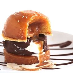 "Burger for dessert? Yes! Sweet ""buns"" of vanilla cake filled & glazed with caramel sauce & a ""patty"" of chocolate covered vanilla ice cream."