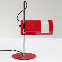 Spider table lamp in red. Designed by Joe Colombo for Oluce Italy 1965. via randcompanynyc