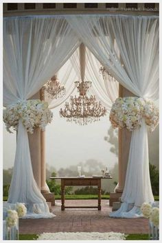 I mean... ideally this would be it.  extravagant-wedding-arch.jpg (513×773)
