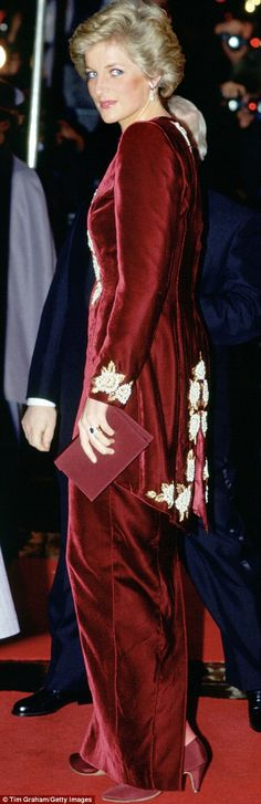 Diana ensured that this burgundy silk-velvet evening dress, with its embroidered tail coat...