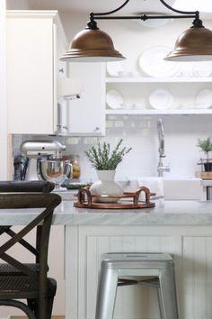 diy-kitchen-remodel-copper-light-update-marble-tile-countertop-subway-tile-backsplash-Zevy-Joy-featured-on-@Remodelaholic
