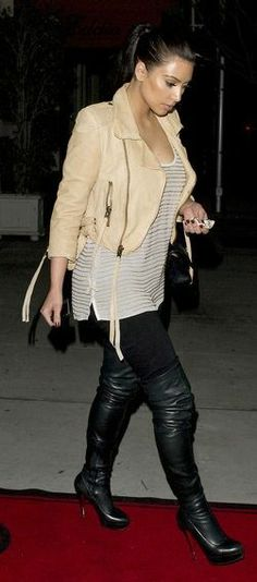 Who made Kim Kardashian's black skinny jeans, black thigh high boots, handbag and nude leather jacket that she wore in Beverly Hills on April 3, 2011? Shoes – Christian Louboutin  Jeans – 7 for mankind  Jacket – Leila Shams  Purse – Chanel