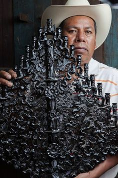 """Beautiful candelabra by Mexican folk artist Manuel Jeronimo Reyes, photographed by Florence Leyret Jeune, from her """"Artisans of Mexico"""" series. via artisanos de Michoacan Mexican Artwork, Mexican Folk Art, Mexican Heritage, Mexican Style, I Love Mexico, Mexican Ceramics, Mexican Crafts, Mexico Art, Mexican Designs"""