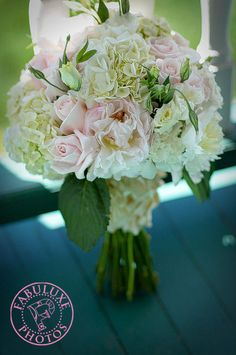 Hand-tied bouquet composed of hydrangea, peonies, roses and lisianthus.
