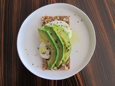 Healthy Snacks - crispbread crackers (Wasa brand popular in grocery stores) with - with  Avocado and Mozzarella