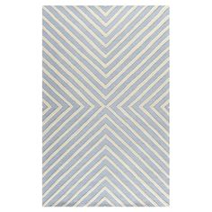 Bring a pop of pattern to your living room or master suite with this hand-tufted wool rug, showcasing diagonal stripes in light blue and ivory. ...