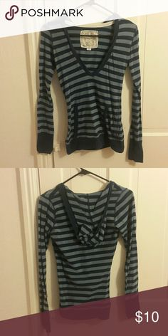 Striped top Blue striped long sleeve top with low v neck and hood Poof! Tops Tees - Long Sleeve