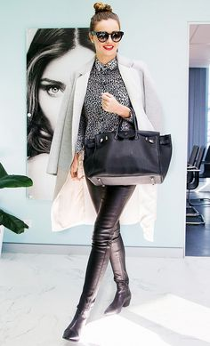 Find Out Which Designer Bags Are Most Popular in Your City via @WhoWhatWear // Miranda Kkerr in black skinnies, animal print blouse, and gray coat.