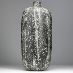 A vertical line pattern emphasizes the height – over 25 inches – of Conover's 'Qibal' vase, which sold in 2009 for $15,860. Image courtesy of Rago Arts and Auction Center.