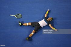 Rafael Nadal of Spain falls to the ground after winning match point in his semifinal match against Fernando Verdasco of Spain during day twelve of the 2009 Australian Open at Melbourne Park on January 30, 2009 in Melbourne, Australia.  (Photo by Cameron Spencer/Getty Images)
