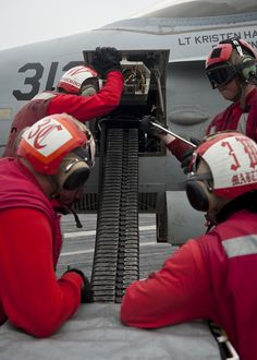 INDIAN OCEAN (June 8, 2013) Sailors load ammunition into an F/A-18C Hornet assigned to the Blue Diamonds of Strike Fighter Squadron (VFA) 146 on the flight deck of the aircraft carrier USS Nimitz (CVN 68). Nimitz Strike Group is deployed to the U.S. 7th Fleet area of responsibility conducting maritime security operations and theater security cooperation efforts. (U.S. Navy photo by Mass Communication Specialist 3rd Class Raul Moreno Jr./Released)