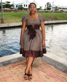 Shweshwe Traditional Dresses Designs South Africa is the home of Shweshwe and cottony cloth, Shweshwe is of South Africa agent but every African African Print Dresses, African Dresses For Women, African Attire, African Wear, African Fashion Dresses, African Women, African Prints, Ghanaian Fashion, African Inspired Fashion