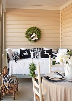 Dress up your existing outdoor furniture with holiday accents to create a wintry patio retreat. Buffalo check decor and reindeer pillows in a black-and-white palette dress up this porch daybed. Best Outdoor Christmas Decorations, Christmas Greenery, Christmas Porch, Xmas Decorations, Christmas Lights, Christmas Ideas, Outdoor Decorations, Cheap Wreaths, Porch Decorating