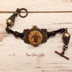 A personal favorite from my Etsy shop https://www.etsy.com/listing/261595116/fleur-de-lys-bracelet