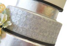 Metallic wedding cakes with KISS logos