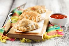 Mini Calzone Recipe. Use store bought pizza dough or use a can of Pillsbury biscuit dough and roll the biscuit out with a rolling pin to make your mini calzone.